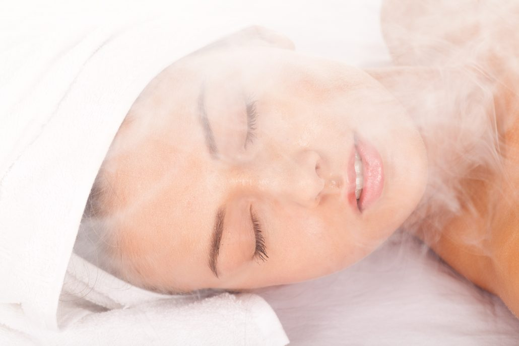 Woman relaxing in her infrared sauna
