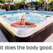 Woman relaxing in Island series hot tub by Artesian Spas