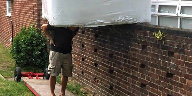 Hot tub installation at customer's home over wall