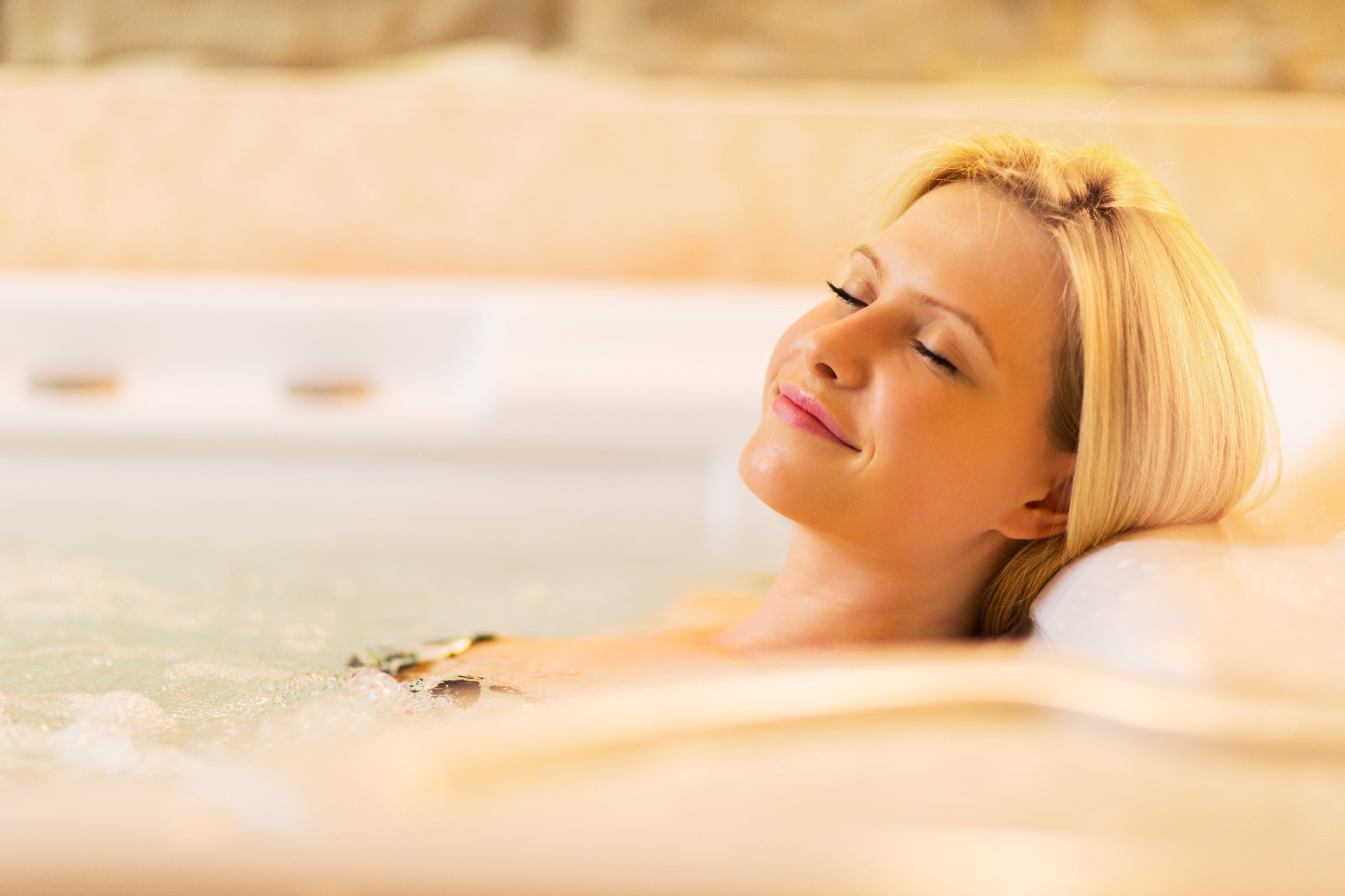 Woman relaxing in Artesian Spa